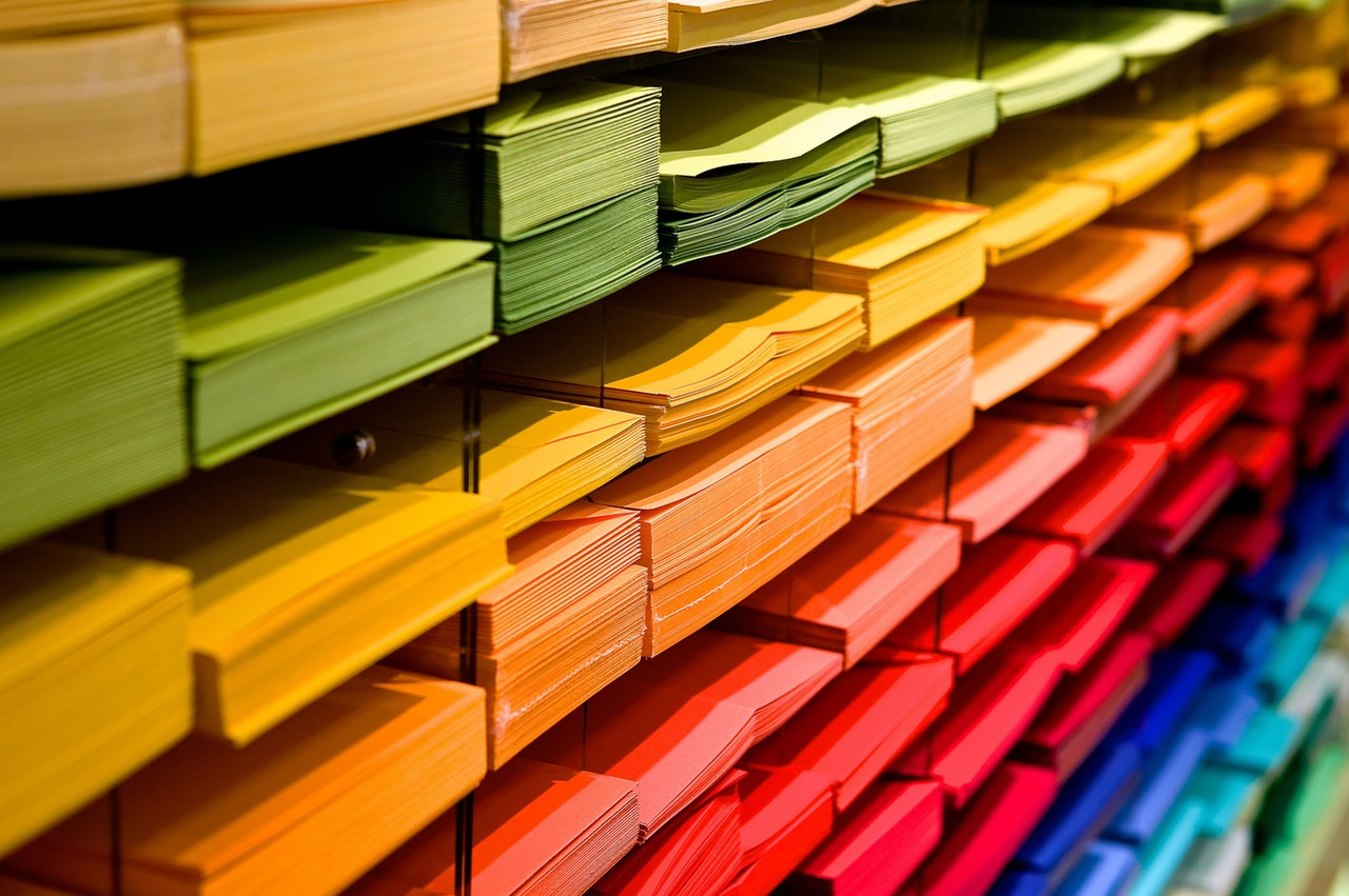 Picture of rainbow arrangement of colored stacks of paper