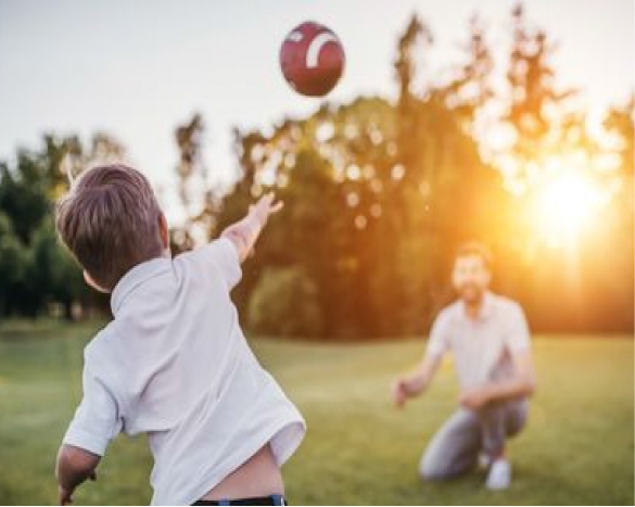 Father and son throwing football image