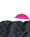 Pink umbrella in crowd of black umbrellas image